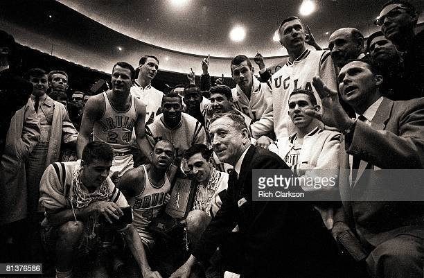 College Basketball NCAA Final Four UCLA coach John Wooden victorious with team trophy and net after winning championship game vs Duke Kansas City MO...