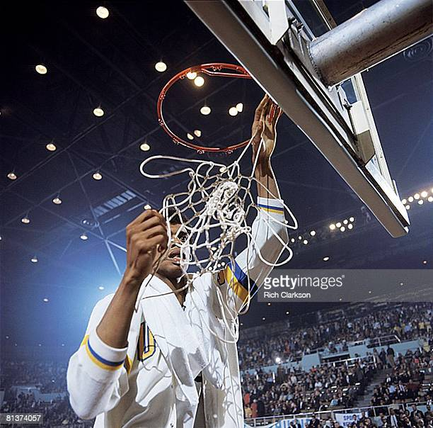 College Basketball NCAA Final Four UCLA Lew Alcindor victorious cutting down net after winning game vs North Carolina Los Angeles CA 3/23/1968