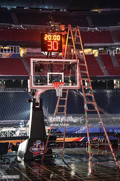 NCAA Final Four View of SI photographer Greg Nelson setting up remote cameras affixed to shot clock prior to games at NRG Stadium Behind the Scenes...