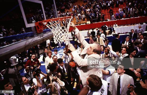 College Basketball NCAA Final Four Villanova coach Rollie Massimino victorious cutting down net after winning championship game vs Georgetown...