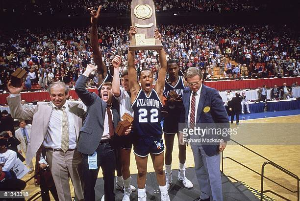 College Basketball NCAA Final Four Villanova Gary McLain victorious with trophy after winning game vs Georgetown Lexington KY 4/1/1985
