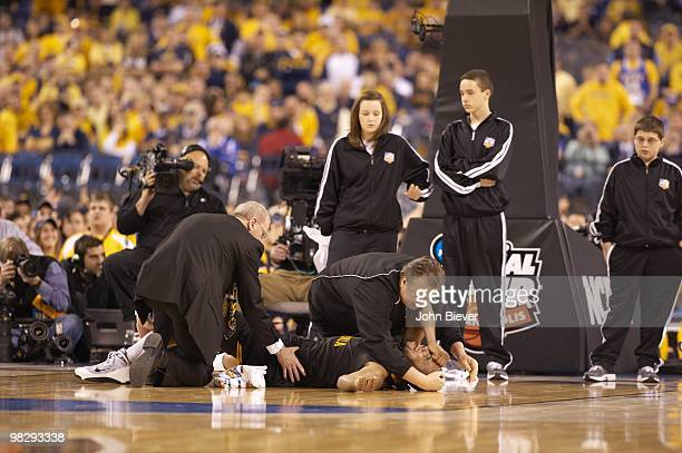 NCAA Final Four West Virgina head coach Bob Huggins with Da'Sean Butler after sustaining injury during game vs Duke Indianapolis IN 4/3/2010 CREDIT...