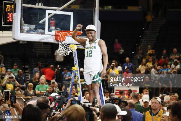 NCAA Finals Baylor Moon Ursin victorious on ladder after cutting net after winning game vs Notre Dame at Amalie Arena Tampa FL CREDIT David E Klutho
