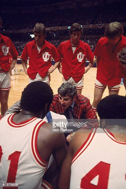 College Basketball NCAA finals Indiana coach Bobby Knight in huddle with team on sidelines during game vs Michigan Philadelphia PA 3/29/1976