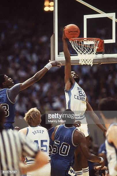College Basketball NCAA Finals North Carolina James Worthy in action making dunk vs Georgetown Patrick Ewing Cover New Orleans LA 3/29/1982