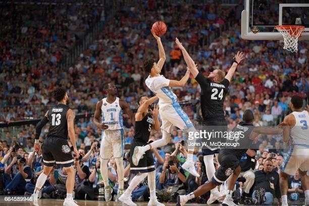 NCAA Finals North Carolina Justin Jackson in action vs Gonzaga Przemek Karnowski at University of Phoenix Stadium Glendale AZ CREDIT John W McDonough