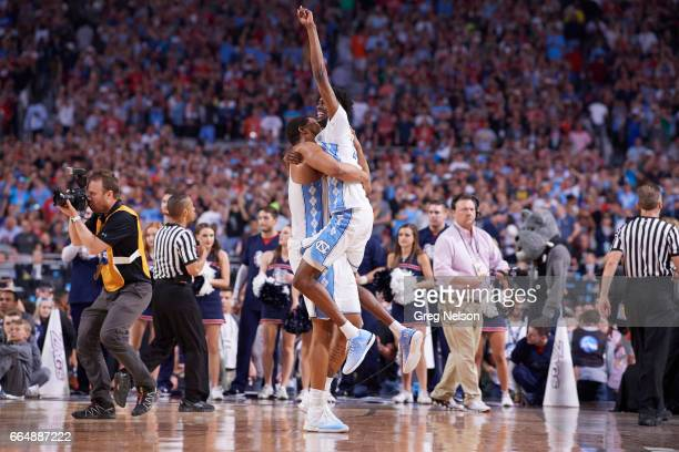 NCAA Finals North Carolina Kennedy Meeks victorious hugging Brandon Robinson on court after winning game vs Gonzaga at University of Phoenix Stadium...