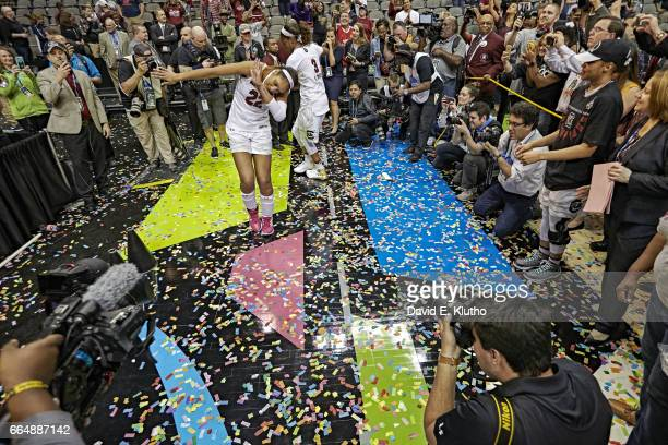 NCAA Finals South Carolina A'ja Wilson victorious dancing in dab pose while surrounded by fans and members of the media after winning game vs...
