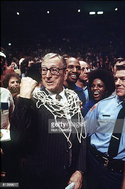 College Basketball NCAA finals UCLA coach John Wooden victorious with net after winning game vs Kentucky San Diego CA 3/31/1975