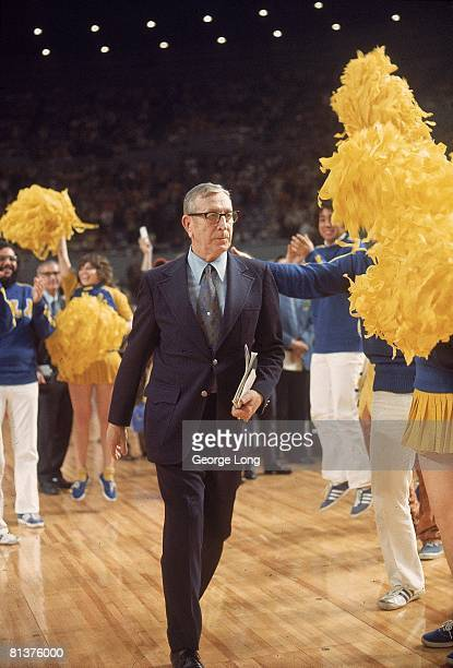 College Basketball: NCAA Finals, UCLA coach John Wooden with cheerleaders entering court before game vs Florida State, Los Angeles, CA 3/23/1972