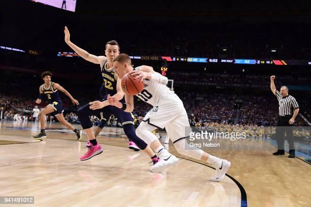 NCAA Finals Villanova Donte DiVincenzo in action vs Michigan Duncan Robinson at Alamodome San Antonio TX CREDIT Greg Nelson