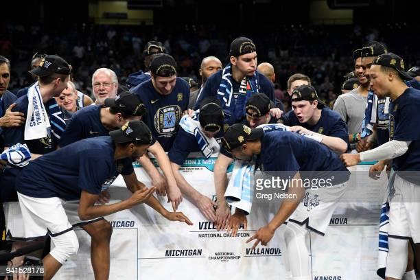 NCAA Finals Villanova players victorious touching oversized bracket after winning game vs Michigan at Alamodome San Antonio TX CREDIT Greg Nelson