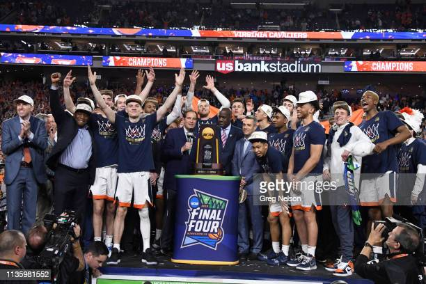 Finals: Virginia coach Tony Bennett with players victoriious on stage with NCAA National Championship trophy and with CBS announcer Jim Natz after...