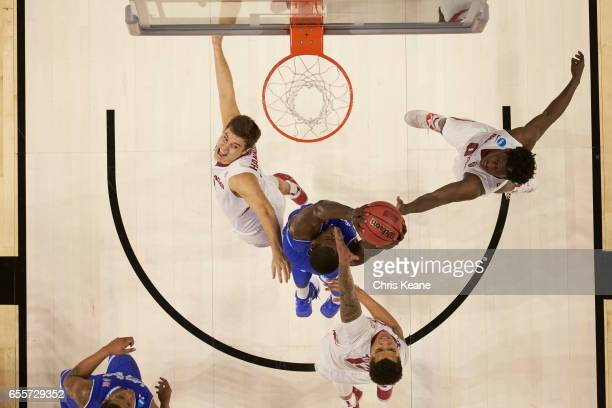 NCAA Playoffs Aerial view of Arkansas Jaylen Barford Dustin Thomas and Dusty Hannahs in action vs Seton Hall at Bon Secours Wellness Arena Greenville...