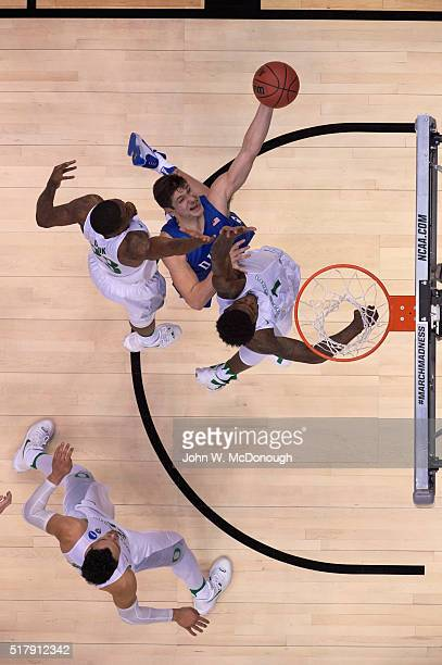 NCAA Playoffs Aerial view of Duke Grayson Allen in action layup vs Oregon Jordan Bell and Elgin Cook at Honda Center Anaheim CA CREDIT John W...