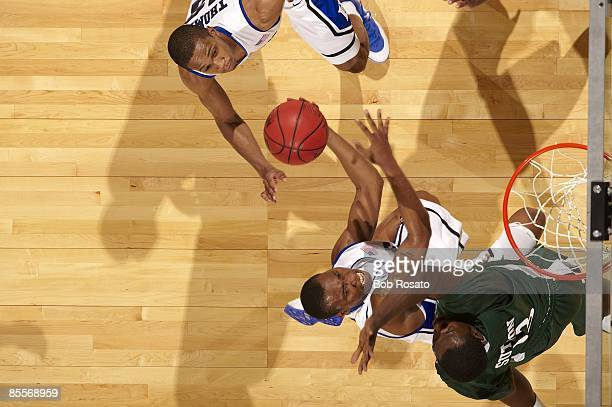 NCAA Playoffs Aerial view of Duke Nolan Smith in action vs Binghamton Kyrie Sutton Greensboro NC 3/19/2009 CREDIT Bob Rosato