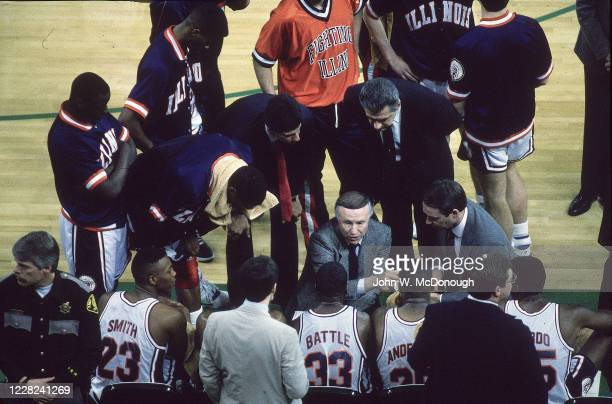 Playoffs: Aerial view of Illinois coach Lou Henson in huddle with players during timeout during game vs Michigan at Kingdome. Seattle, WA 4/1/1989...