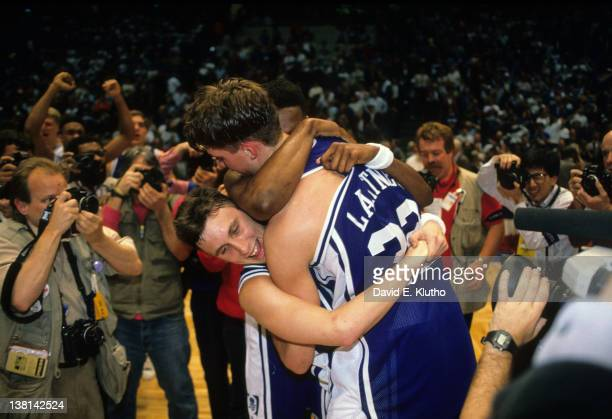 NCAA Playoffs Duke Christian Laettner and Bobby Hurley victorious hugging on court after gamewinning shot vs UConn at the Brendan Byrne Arena East...