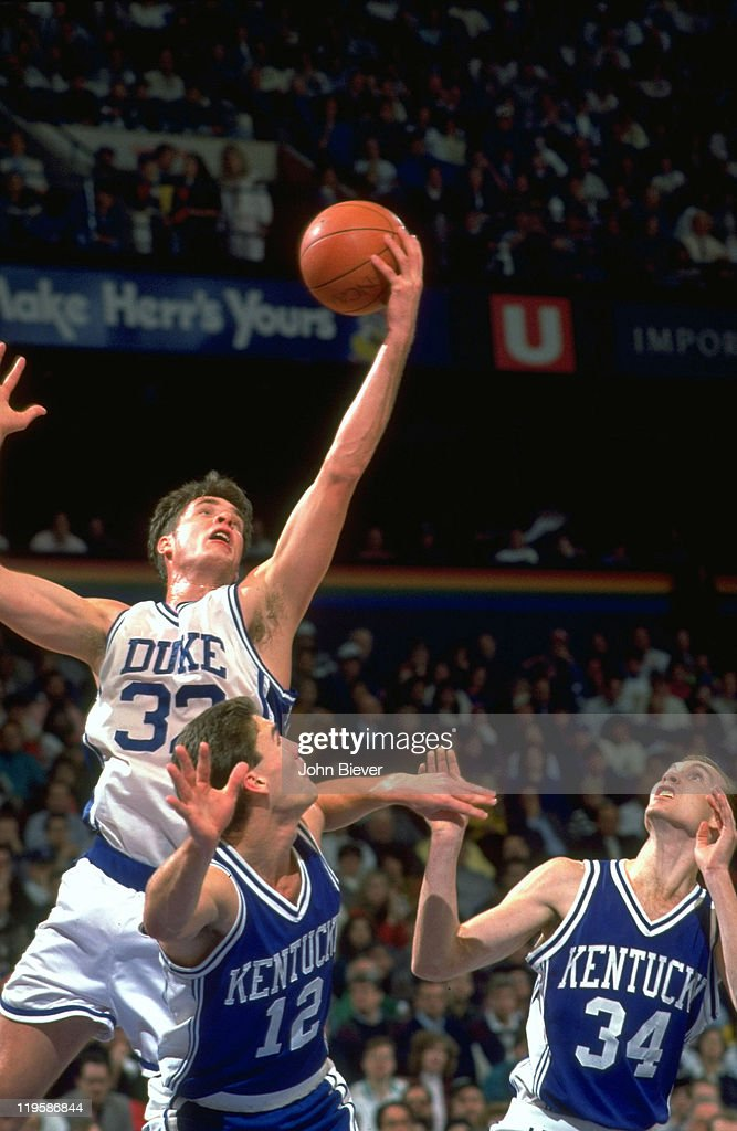 Duke Christian Laettner (32) in action, rebounding vs Kentucky Sean Woods (11) during game at The Spectrum. John Biever X42666 )