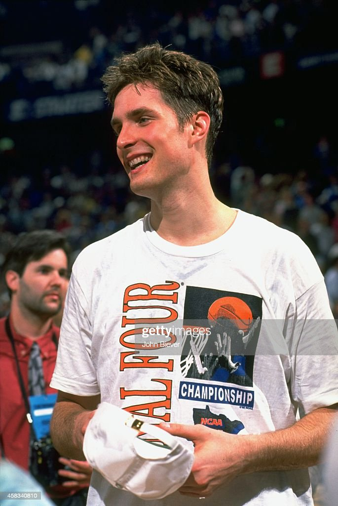 Duke Christian Laettner (32) victorious on court after winning game vs Kentucky at The Spectrum. John Biever X42666 )