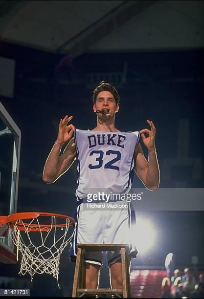 College Basketball NCAA playoffs Duke Christian Laettner victorious popping jersey before cutting net after winning game vs St John's Pontiac MI...