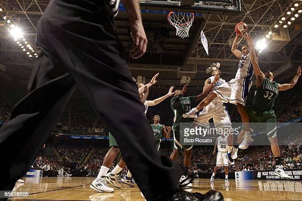 NCAA Playoffs Duke Gerald Henderson in action getting rebound vs Binghamton Emanuel Mayben Greensboro NC 3/19/2009 CREDIT Bob Rosato