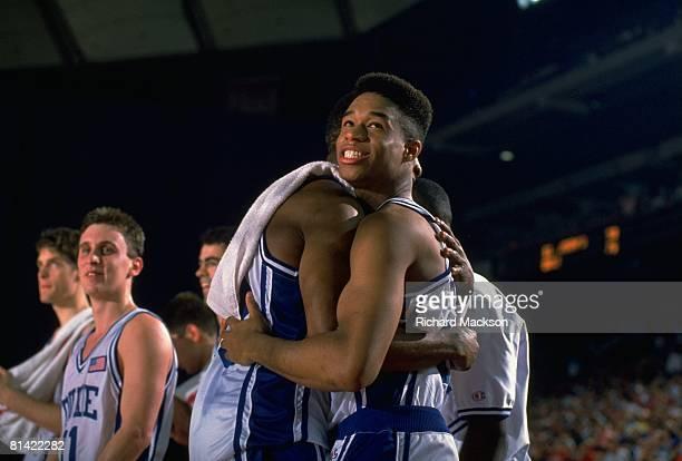 College Basketball NCAA playoffs Duke Thomas Hill victorious hugging teammate after winning game vs St John's Pontiac MI 3/22/1991
