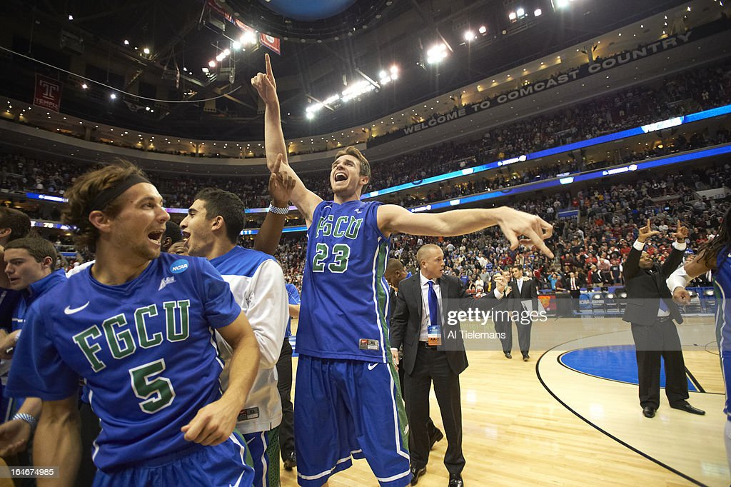 Florida Gulf Coast Eddie Murray (23) and Christophe Varidel (5) victorious on court after winning game vs Georgetown at Wells Fargo Center. Al Tielemans X156289 TK3 R3 F31 )