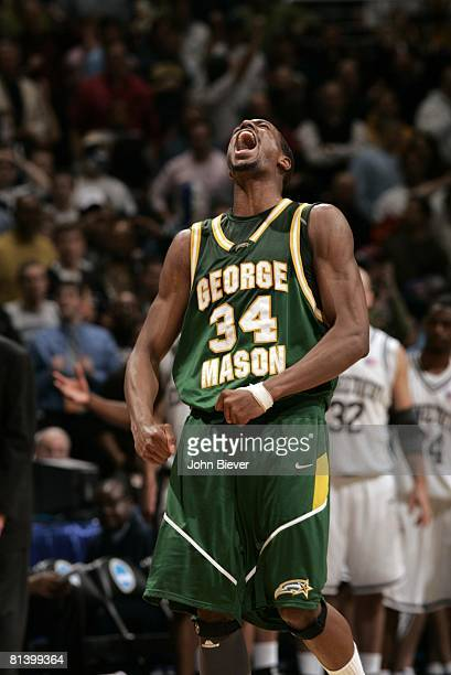 College Basketball: NCAA Playoffs, George Mason Will Thomas victorious on court during game vs UConn, Washington, DC 3/26/2006