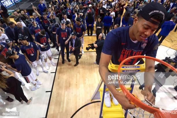 NCAA Playoffs Gonzaga Rui Hachimura on ladder cutting net after winning game vs Xavier at SAP Center San Jose CA CREDIT John W McDonough