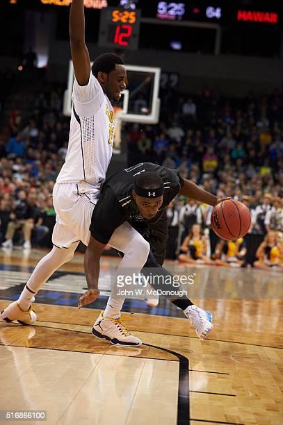 NCAA Playoffs Hawaii Roderick Bobbitt in action vs Cal Berkeley Roger Moute a Bidias at Spokane Veterans Memorial Arena Spokane WA CREDIT John W...