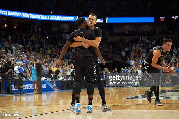 NCAA Playoffs Hawaii Stefan Jovanovic and Roderick Bobbitt victorious hugging after winning game vs Cal Berkeley at Spokane Veterans Memorial Arena...