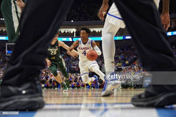 NCAA Playoffs Kansas Devonte' Graham in action vs Michigan State at BOK Center Tulsa OK CREDIT Greg Nelson