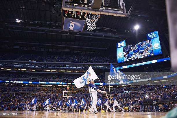 NCAA Playoffs Kentucky cheerleaders on court with flags during game vs Michigan at Lucas Oil Stadium Indianapolis IN CREDIT David E Klutho