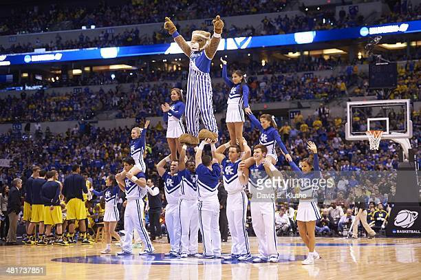 NCAA Playoffs Kentucky cheerleaders performing pyramid with Wildcats mascot The Wildcat during game vs Michigan at Lucas Oil Stadium Indianapolis IN...