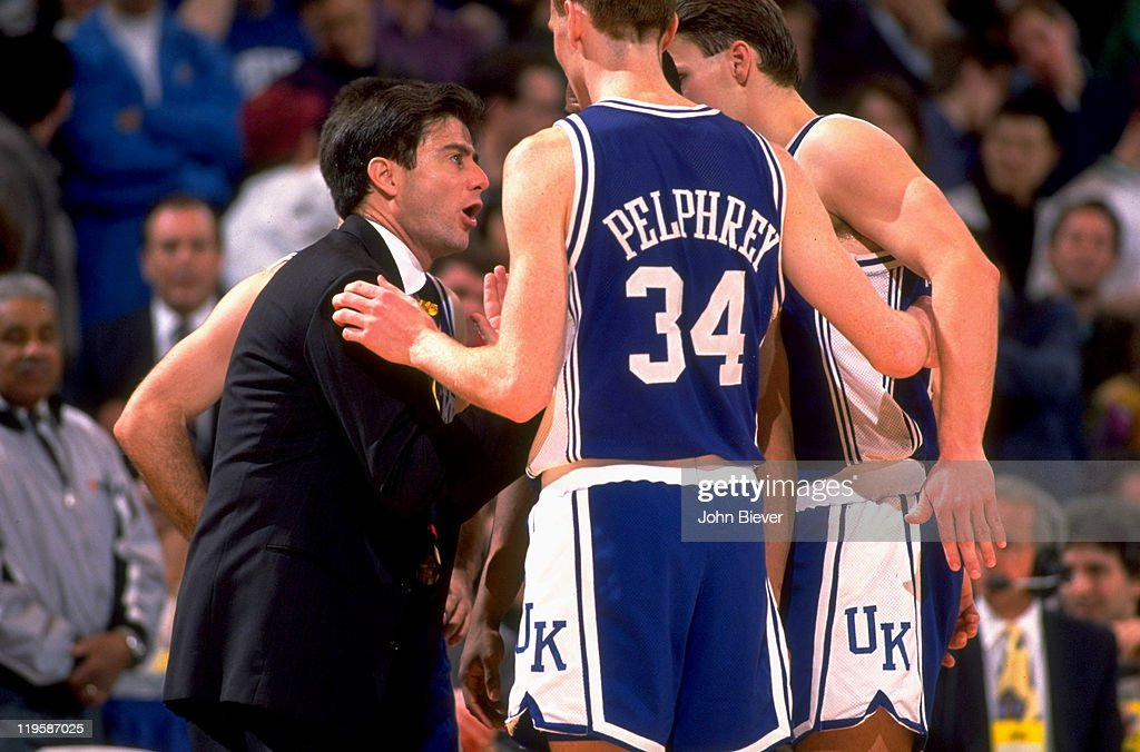 Kentucky coach Rick Pitino talking to John Pelphrey (34) and teammates during game vs Duke at The Spectrum. John Biever X42666 )