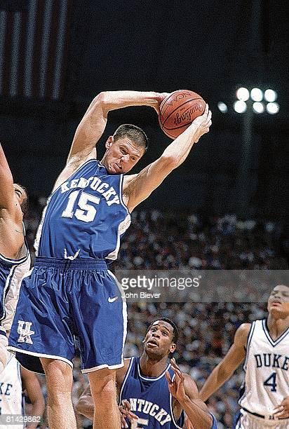 College Basketball NCAA playoffs Kentucky Jeff Sheppard in action getting rebound vs Duke St Petersburg FL 3/22/1998