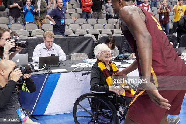 NCAA Playoffs Loyola Chicago fan and nun Sister Jean DoloresSchmidt greeting Donte Ingram on court in wheelchair before game vs Miami at American...