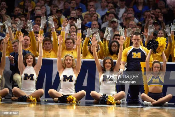 NCAA Playoffs Michigan cheerleaders sitting on court during game vs Florida State at Staples Center Los Angeles CA CREDIT John W McDonough