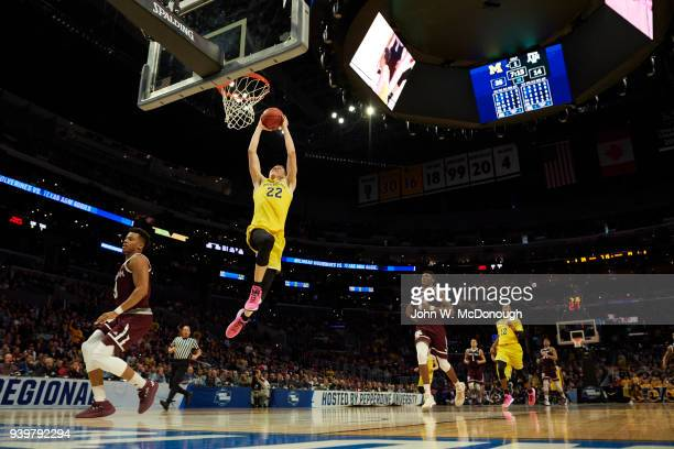 NCAA Playoffs Michigan Duncan Robinson in action dunk vs Texas AM at Staples Center Los Angeles CA CREDIT John W McDonough