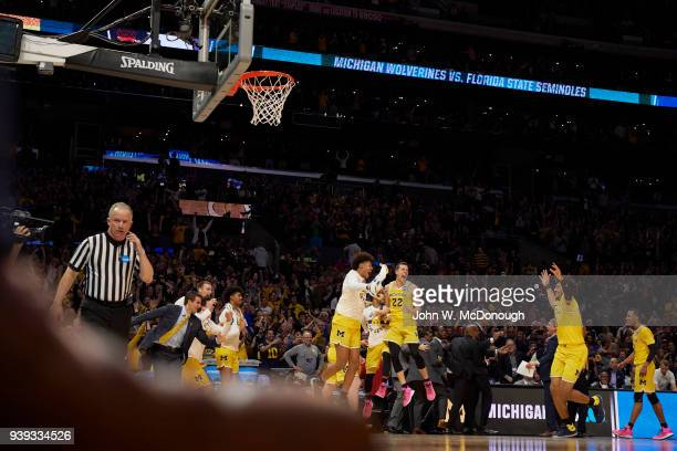 NCAA Playoffs Michigan Isaiah Livers and Duncan Robinson victorious on court with teammates after winning game vs Florida State at Staples Center Los...