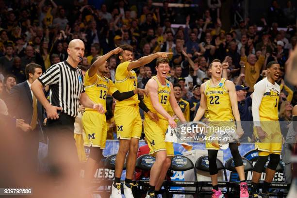 NCAA Playoffs Michigan Isaiah Livers Duncan Robinson and teammates victorious on sidelines bench during game vs Texas AM at Staples Center Los...