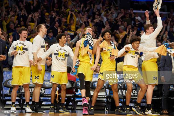 NCAA Playoffs Michigan Isaiah Livers Jordan Poole Duncan Robinson and teammates victorious on sidelines bench during game vs Texas AM at Staples...