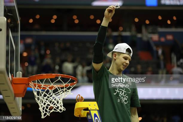 NCAA Playoffs Michigan State Matt McQuaid victorious on ladder after cutting net after winning game vs Duke at Capital One Arena Washington DC CREDIT...