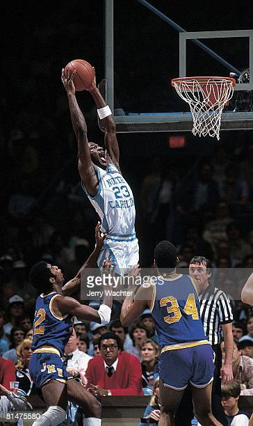 College Basketball: NCAA playoffs, North Carolina Michael Jordan in action, making dunk vs James Madison, Greensboro, NC 3/19/1983