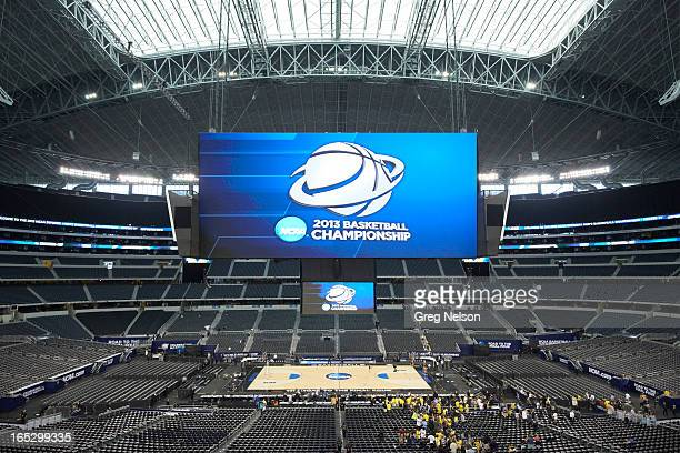 NCAA Playoffs Overall view of HD video screen with NCAA logo over court before Michigan vs Florida game at Cowboys Stadium Arlington TX CREDIT Greg...