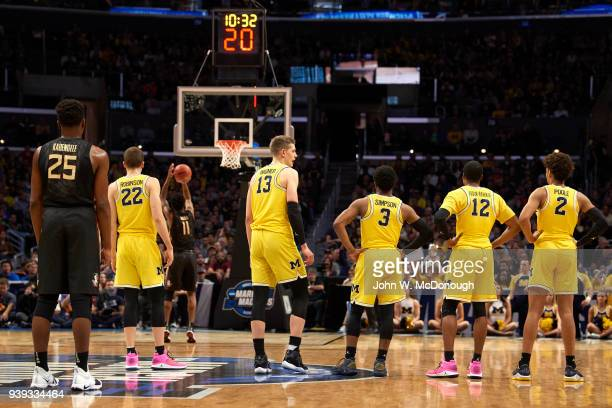 NCAA Playoffs Rear view of Michigan Duncan Robinson Moritz Wagner Zavier Simpson MuhammadAli Abdur Rahkman and Jordan Poole during game vs Florida...