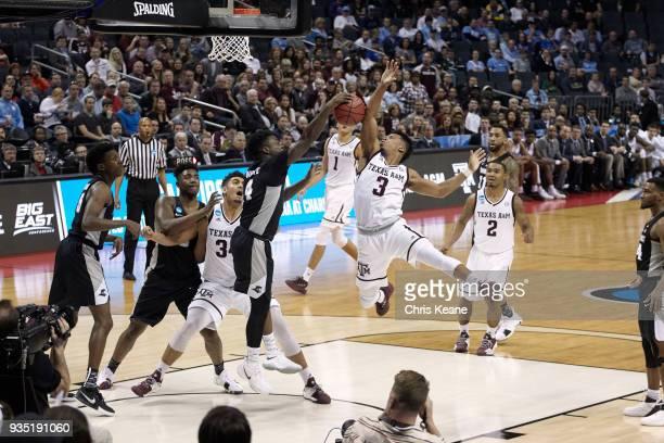 NCAA Playoffs Texas AM Admon Gilder in action vs Providence Maliek White at Spectrum Center Charlotte NC CREDIT Chris Keane