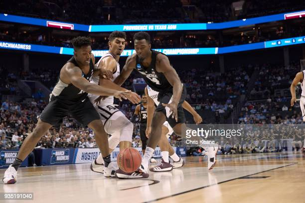NCAA Playoffs Texas AM Tyler Davis in action vs Providence Isaiah Jackson and Kalif Young at Spectrum Center Charlotte NC CREDIT Chris Keane