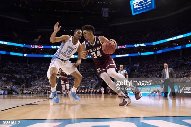 NCAA Playoffs Texas AM Tyler Davis in action vs North Carolina Garrison Brooks at Spectrum Center Charlotte NC CREDIT Chris Keane